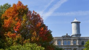 Marston Hall and the Four Muses take in the turning colors.