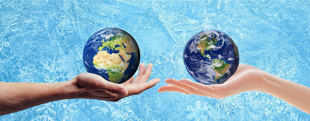 two hands each holding the world