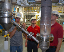 Jordan Funkhouser, Lysle Whitmer and Marty Haverly, left to right, helped redesign and rebuild Iowa State's fast pyrolysis pilot plant. - Photo by Bob Mills of the Bioeconomy Institute
