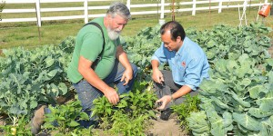 Lie Tang (right) talks with Ken Blackledge about how his robot will be designed to aid organic farmers. Blackledge owns and operates Black Cat Acres in Nevada, Iowa, with his wife and children.