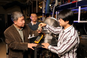 Xinwei Wang, Guoqing Liu and Xiaopeng Huang, left to right, show the instruments they used to study the thermal conductivity of spider silk