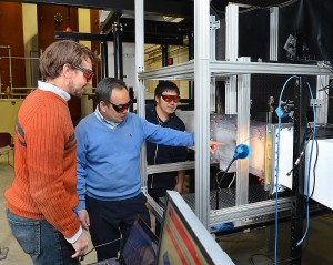 Rye Waldman, Hui Hu, and Kai Zhang, left to right, work with the Iowa State University Icing Research Tunnel.  Photo by Bob Elbert.