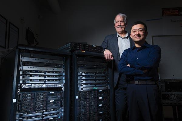 Doug Jacobson, University Professor of electrical and computer engineering, left, and Daji Qiao, associate professor of electrical and computer engineering
