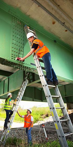 researchers gather data on bridge structure
