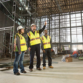researchers examine building interior during construction