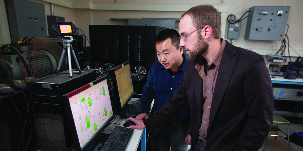 (Zhaoyu Wang, assistant professor of electrical and computer engineering, and Nick David, graduate student in electrical and computer engineering)