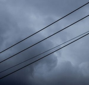 powerlines against a cloudy sky