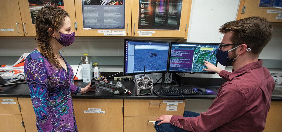 Colton Glick and Kristin Y. Rozier in the lab